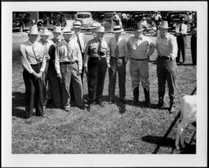 Primary view of object titled '[Albert Peyton George and nine other men wearing hats]'.