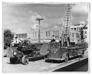 Primary view of object titled '[Old and New Fire Trucks]'.