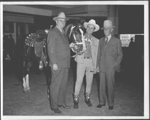Primary view of object titled '[Albert Peyton George, Gene Autry, and Virgil Shepherd standing next to a horse]'.