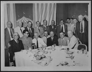 Primary view of object titled '[Group of men dining at a Houston hotel]'.