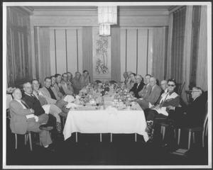 Primary view of object titled '[Albert Peyton George and a group of men in the dining room of a Houston hotel]'.
