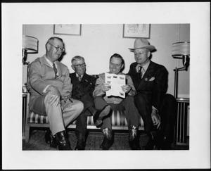 Primary view of object titled '[Albert Peyton George, Gene Autry, and two unidentified men]'.