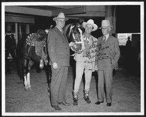 [Albert Peyton George, Gene Autry, and Virgil Shepherd standing next to a horse]