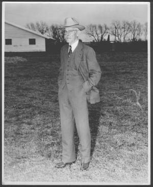 Primary view of object titled '[Albert Peyton George at George Ranch standing with his hands in his pockets]'.