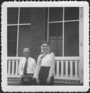 [Mr. Albert George and Ruth Forsgard in front of the ranch house porch]
