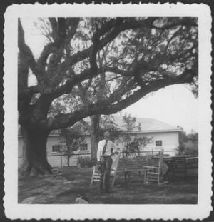 Primary view of object titled '[Mr. Albert George standing in the George ranch yard]'.