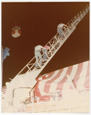 Primary view of object titled '[Firefighters and Girl Climbing Down Rescue Ladder]'.
