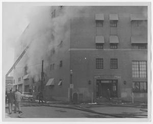 Primary view of object titled '[Firefighter's Ladder Extending Towards Smoking Building on Pacific and Griffin]'.