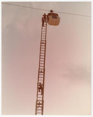 Primary view of object titled '[Firefighters Rescue Sky Tram Rider at the Fair]'.