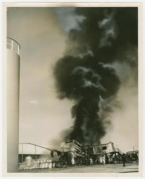 Primary view of object titled '[Cloud of Black Smoke Rising from Metal Building]'.