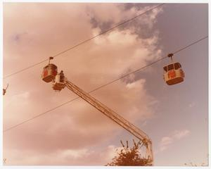 Primary view of object titled '[Aerial Lift Crane Used to Reach Sky Tram Car]'.