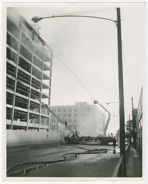 Primary view of object titled '[Firefighters Spray Down Unfinished Courthouse]'.