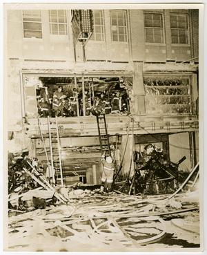 Primary view of object titled '[Firefighters Climb Into Fire-Damaged Medical Arts Building]'.