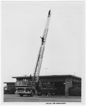 Primary view of object titled '[Firefighters Climb Fire Engine Ladder]'.
