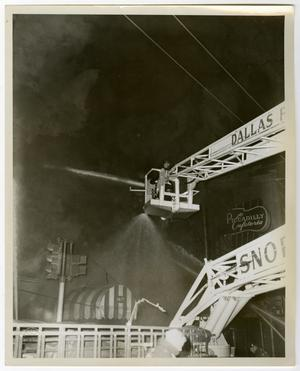 Primary view of object titled '[Firefighters Hose Down Smoking Building From Above]'.