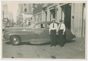 Primary view of object titled '[Fire Chief Funk, Assistant Chief Long with Chief's car]'.