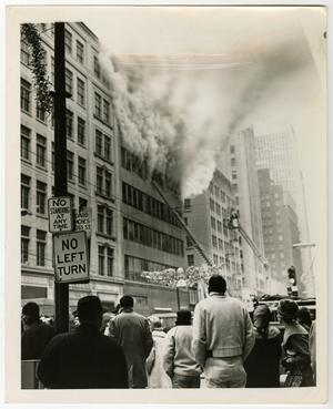Primary view of object titled '[Crowd Watches Smoking Neiman-Marcus Building]'.
