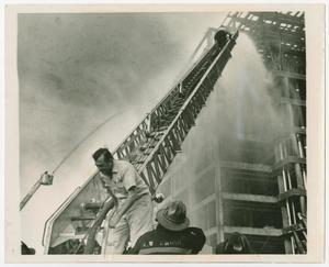 Primary view of object titled '[Firefighters Hose Down an Unfinished Building]'.