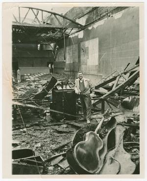 Primary view of object titled '[Man Standing In Rubble of Burned Kessler Theatre]'.