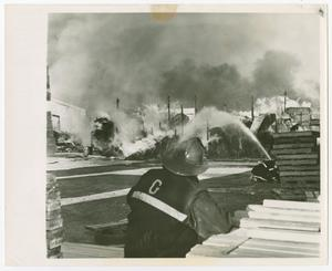 [Firefighters Extinguishing a Blazing Structure]