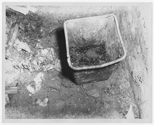 Primary view of object titled '[Burned Bin Sitting in Ash and Rubble]'.