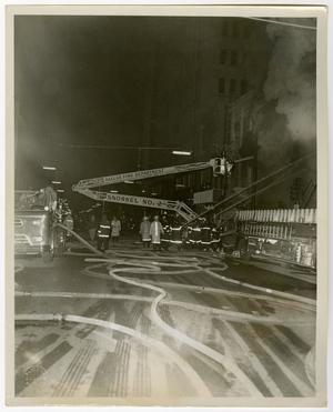 Primary view of object titled '[Dallas Firefighters Use Aerial Platform to Fight a Fire]'.