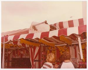 Primary view of object titled '[Broken Sky Tram Car On Top of Carnival Tent]'.