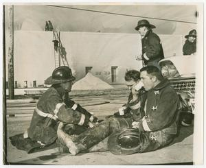 Primary view of object titled '[Firefighters Rest With Refreshments]'.