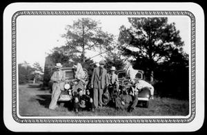 Primary view of object titled '[Albert Peyton George with a group of men after hunting deer and turkey]'.