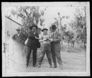 Primary view of object titled '[Photograph of four men]'.