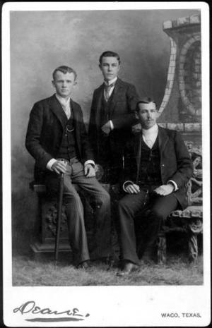 Primary view of object titled '[Albert Peyton George and two unidentified men wearing dark suits]'.