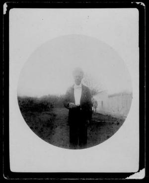 [Albert Peyton George wearing a dark suit, white shirt, bow tie, and derby hat]