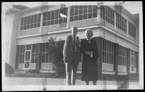 Primary view of object titled '[Albert Peyton George and Mamie George standing in the yard of the George home]'.