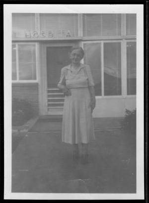 Primary view of object titled '[Photograph of Mamie Davis George standing on the sidewalk]'.