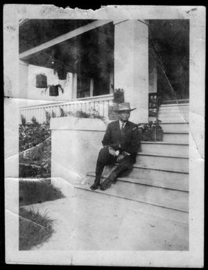[Photograph of T. W. Davis sitting on the steps]