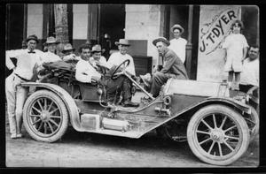 Primary view of object titled '[Nine men and a little girl gathered around an automobile]'.