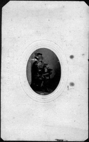 Primary view of object titled '[Albert Lamar George as a young boy, sitting with his legs crossed]'.