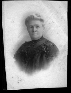 Primary view of object titled '[Belle Ryon Davis wearing a dark high neck collar dress]'.