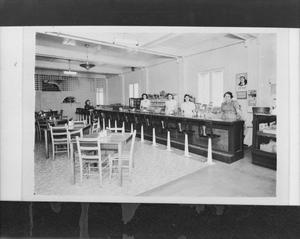 Primary view of object titled '[Women Wait Behind a Counter of a Restaurant]'.