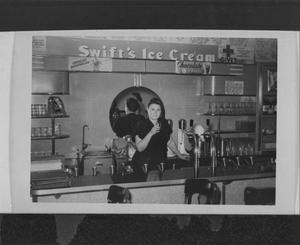Primary view of object titled '[A Woman at Swift's Ice Cream]'.