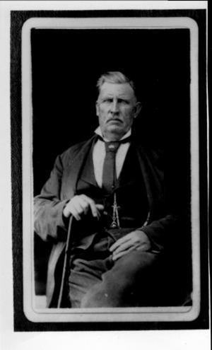 [William Kinchen Davis seated, with his right hand on a cane]