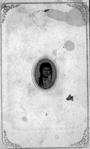 Primary view of object titled '[Head portrait of a young woman wearing a light print dress]'.