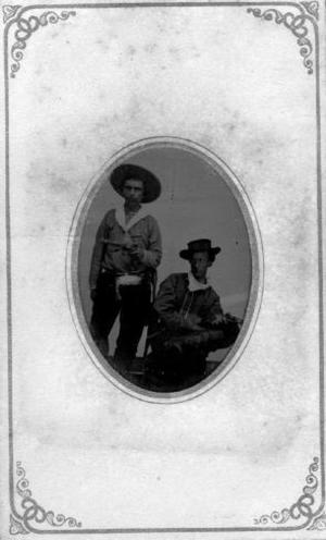 Primary view of object titled '[Two men holding pistols and wearing hats]'.