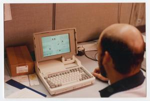 Primary view of object titled '[Man using a closed-loop computer system]'.