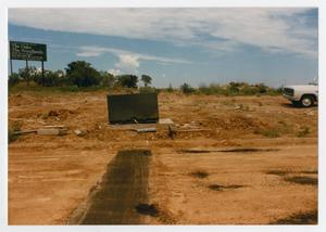 Primary view of object titled '[Dirt lot with sign for future developments]'.