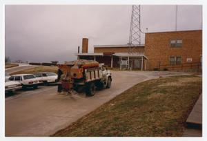 Primary view of object titled '[Truck in emergency entrance of Flow Memorial Hospital]'.