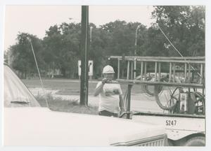Primary view of object titled '[Lineman standing by a truck on Bell Avenue]'.