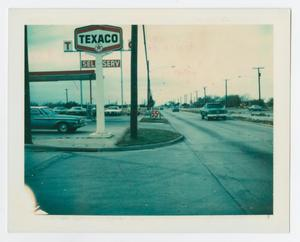 [Chism Texaco service sign on W. University Drive]