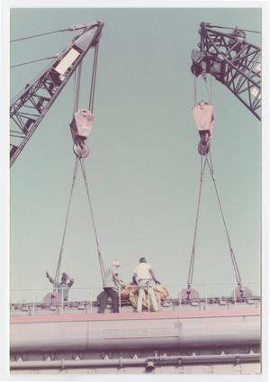 Primary view of object titled '[Men attaching cranes at old power plant]'.