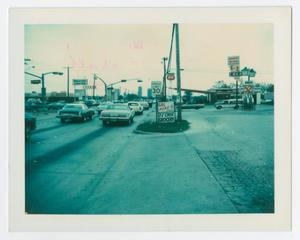 Primary view of object titled '[Cars at intersection of W. University Drive and Malone St.]'.